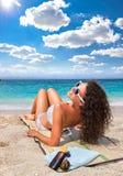 Beautiful woman on Sarakiniko beach, Greece. stock photo