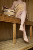 Beautiful woman in sauna, bath accessories Royalty Free Stock Images
