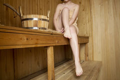 Beautiful woman in sauna, bath accessories Royalty Free Stock Photos