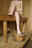 Beautiful woman in sauna, bath accessories Royalty Free Stock Photography