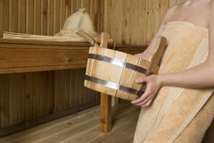 Beautiful woman in sauna, bath accessories Stock Photography