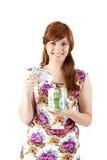Beautiful woman saving money. On white background Royalty Free Stock Image
