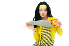 Beautiful woman with a saw Stock Photo