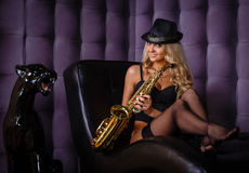 Beautiful woman with saxophone. Royalty Free Stock Photo