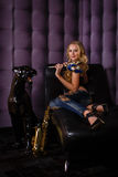 Beautiful woman with saxophone. Royalty Free Stock Image