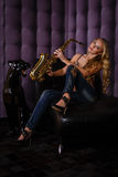 Beautiful woman with saxophone. Stock Photography