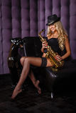 Beautiful woman with saxophone. Stock Photo