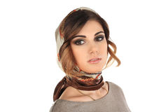 Beautiful woman in a scarf on her head isolated Stock Photo