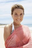 Beautiful Woman With Scarf Standing On Beach Stock Image