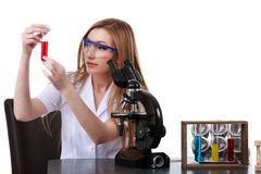 Beautiful woman scientist in the lab perform various operations Stock Photography