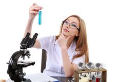 Beautiful woman scientist in the lab perform various operations Royalty Free Stock Image
