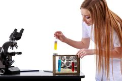 Beautiful woman scientist in the lab perform various operations Stock Photo