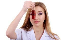 Beautiful woman scientist in the lab perform various operations Stock Images