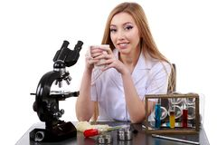 Beautiful woman scientist in laboratory with coffee Royalty Free Stock Photo