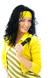 Beautiful woman with a screwdriver winks to us Stock Photos