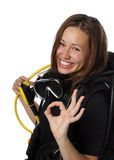 Beautiful woman scuba diver. Shows sign OK on a white background Royalty Free Stock Images