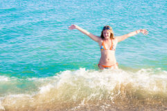 Beautiful woman and sea. Beautiful woman and blue sea Royalty Free Stock Photography