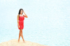 Beautiful woman by the sea Royalty Free Stock Photos