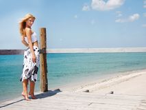 Beautiful woman on sea background Stock Photography