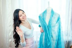 Free Beautiful Woman Seamstress With Long Dark Hair Drapes The Fabric On Mannequin . The Tailor Chooses The Color Of The Stock Images - 159993874