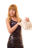 Beautiful woman searches for something in a bag Stock Photography