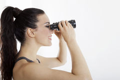 Beautiful woman searching with binoculars Stock Photo