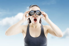 Beautiful woman searching with binoculars Royalty Free Stock Images
