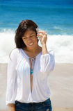 Beautiful woman with seashell on the beach Royalty Free Stock Photography