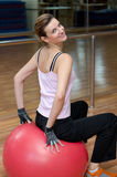 Beautiful Woman Seated on an Exercise Ball Stock Image