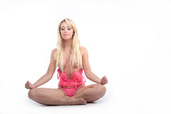 Beautiful woman seated in lotus position Stock Image