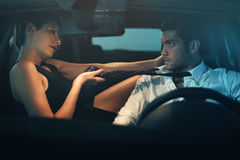 Beautiful woman seducing driver inside a car stock photos