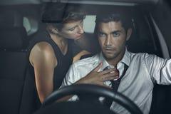 Beautiful woman seducing driver Stock Image