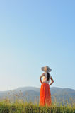 Beautiful Woman see mountain with blue on blue sky Stock Photography