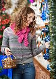 Beautiful Woman Selecting Christmas Ornaments Royalty Free Stock Photos