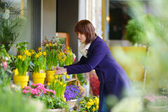 Beautiful woman selecting flowers at flower market Stock Photo