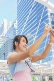 Beautiful woman selfie in city. Beautiful woman selfie in urban landscape Stock Image