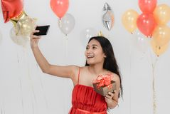 Beautiful woman selfie with gift box at party stock photography