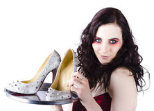 Pretty woman selling shoes on silver plate Royalty Free Stock Photo
