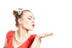 Beautiful woman sending an air kiss. Smiling beautiful woman sending an air kiss Royalty Free Stock Photos