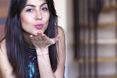 Beautiful woman  sending a kiss Stock Photo