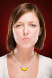 Beautiful woman sending kiss on red Royalty Free Stock Photos