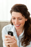 Beautiful woman sending a text message Stock Image