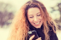 Beautiful woman sending text message from her mobile phone Royalty Free Stock Photography