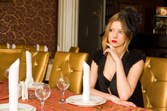 Beautiful woman at served table Royalty Free Stock Photography