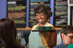 Beautiful Woman Serving Drinks Royalty Free Stock Images