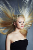 Beautiful woman. Sexy blond girl.healthy hair.Beauty salon.flying hair Stock Photo