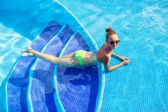 Beautiful woman with sexy body by the pool Stock Photo