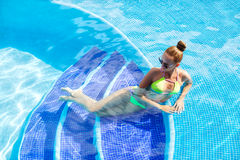 Beautiful woman with sexy body by the pool Stock Photography