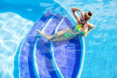 Beautiful woman with sexy body by the pool Royalty Free Stock Photography