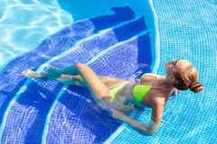 Beautiful woman with sexy body by the pool Royalty Free Stock Photo